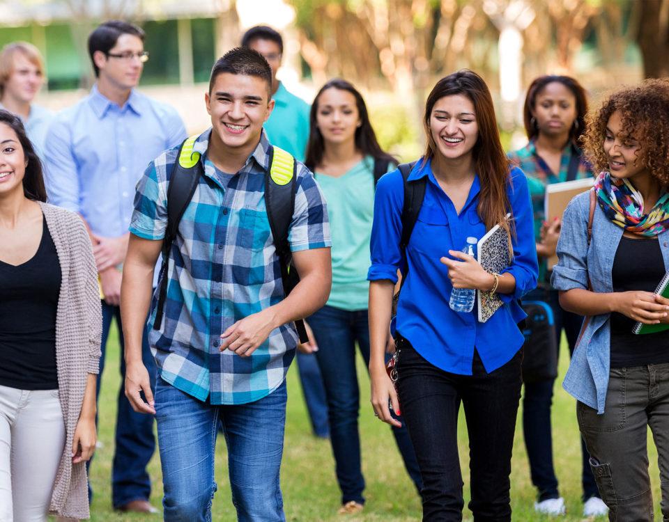 Group of high school friends walking towards camera