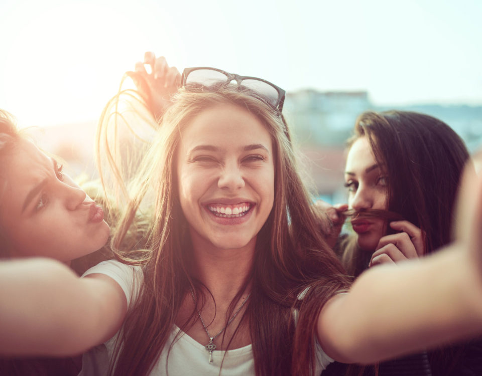 Group of three young women taking a selfie